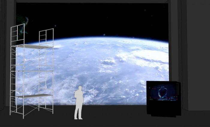 Un personnage sur scène devant une image de la Terre depuis l'espace